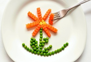 peas and carrots in a flower