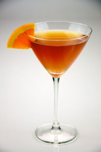 Sidecar in a Martini Glass garnished with lemon wedge